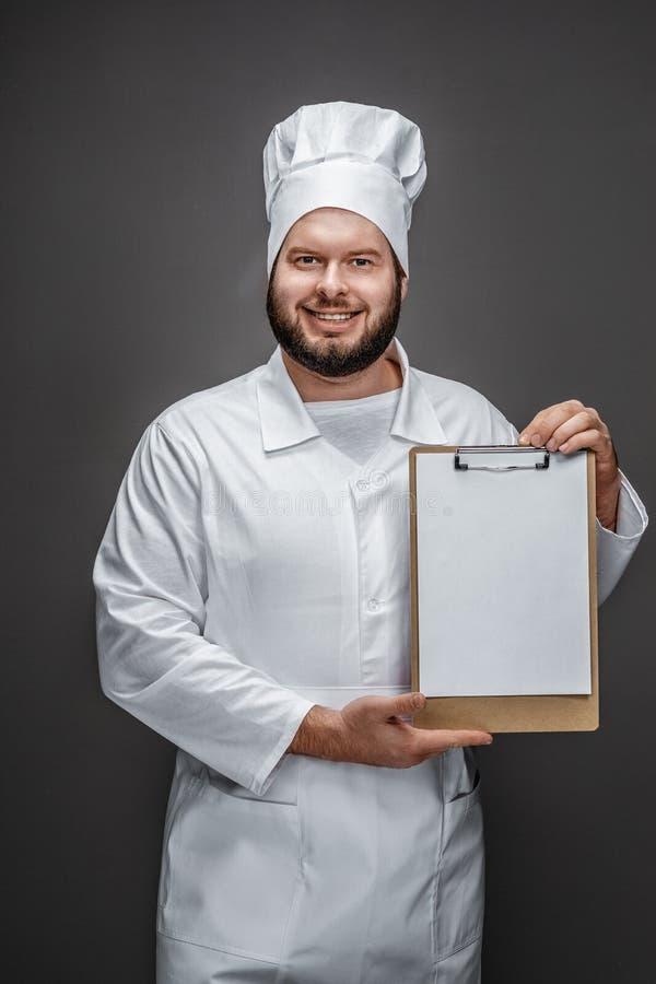 Tablero vacío de la demostración barbuda del cocinero imagenes de archivo