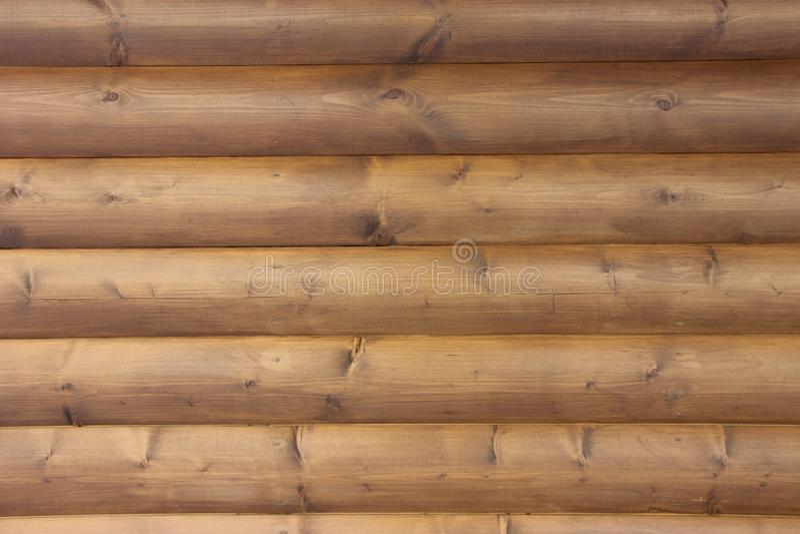Tableros de madera naturales de Brown con el fondo de la pared de los nudos imágenes de archivo libres de regalías
