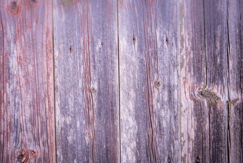 Tableros de madera rojos grises verticales del fondo del primer viejos foto de archivo