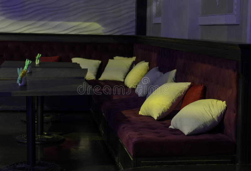 Tables and benches in a bar or nightclub stock image
