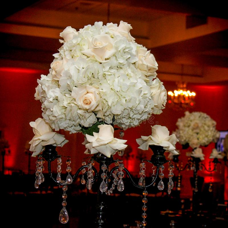 Table Centerpiece at a Wedding Reception. The tables and chairs have been set up and the decorations have all been placed on the tables, just waiting for the stock image