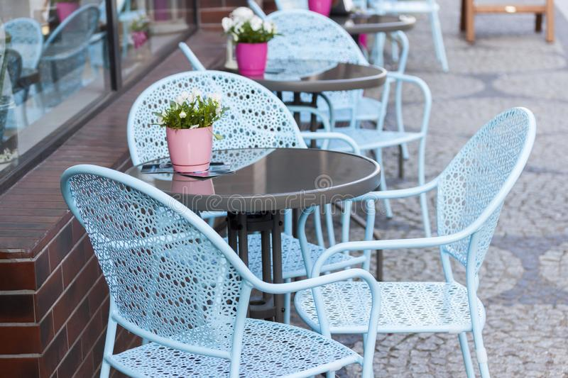 Tables and chairs in outdoor cafe royalty free stock photo
