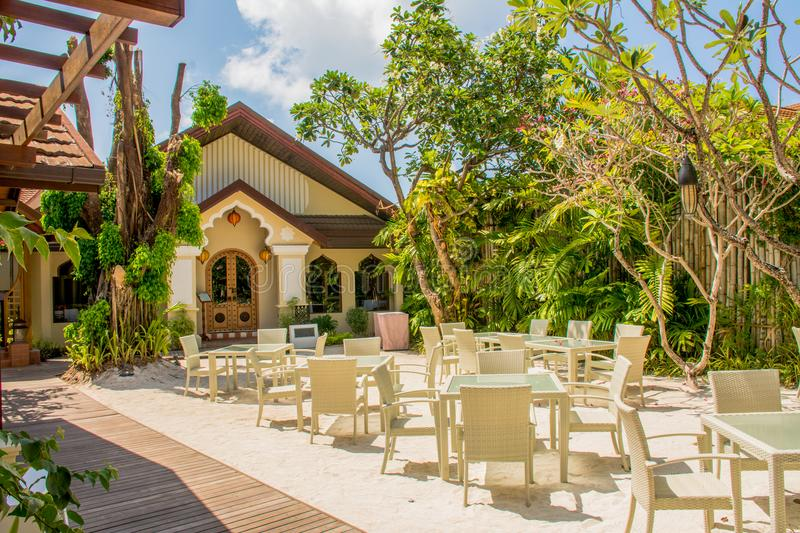 Tables and chairs setup for breakfast at the restaurant at the tropical resort stock photos