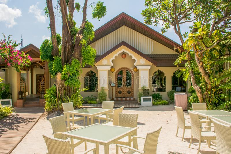 Tables and chairs setup for lunch at the restaurant at the tropical resort stock photography