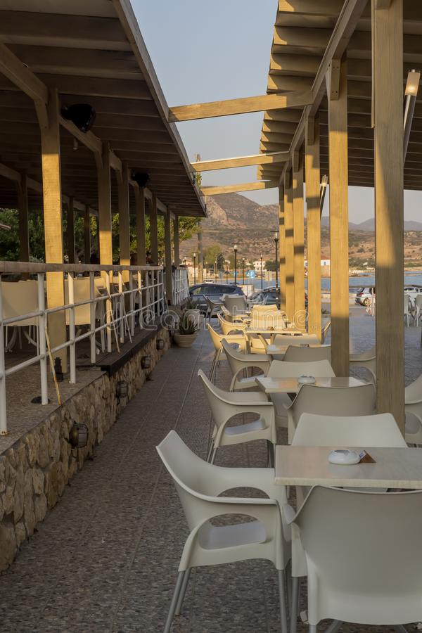 Tables and chairs of a street cafe Greece, Peloponnese stock photos