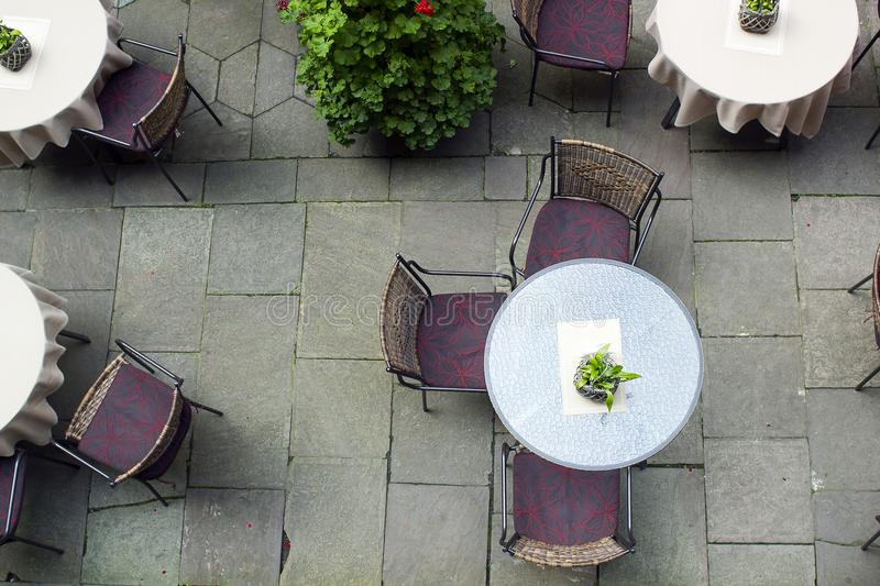 Tables and chairs on terrace, top view royalty free stock photography