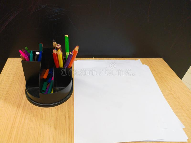 Tables with colored pens in school classroom children`s drawings on the wall. No people. Slow motion. Children`s table and penci. Ls royalty free stock images