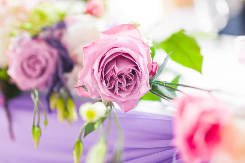 Tables decorated with flowers. Closeup details. Celebratory tables in the banquet hall decorated with flowers closeup royalty free stock images