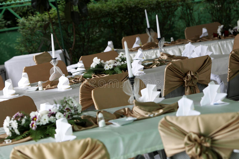Tables in the garden stock images