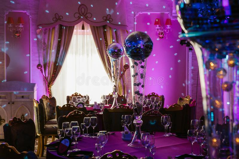 Tables on party served with glasses and discoballs royalty free stock photos