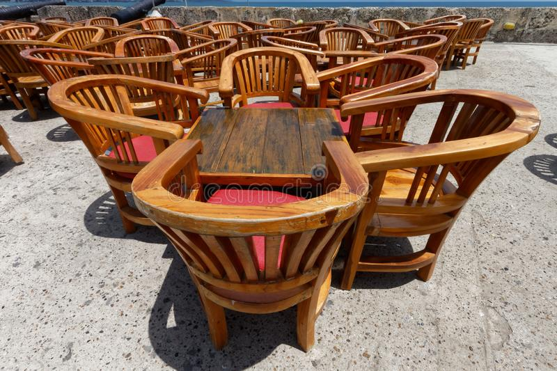 Tables of a ramparts restaurant 2. Tables and chairs of a ramparts restaurant. Chairs and tables made of wood. On a clear sunny summer day. Blue sky n the stock photo