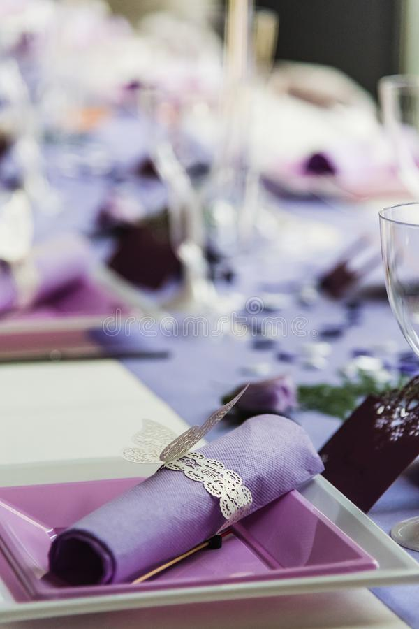 Tables set in the reception hall of a wedding stock photography