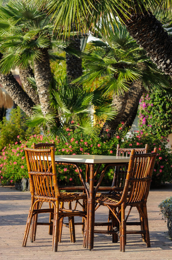 Tables and wicker chairs in the restaurant in Italy royalty free stock image