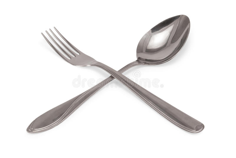 Tablespoon and fork. Crisscrossing tablespoon and fork on white background royalty free stock photos
