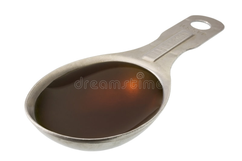 Tablespoon of maple syrup royalty free stock images