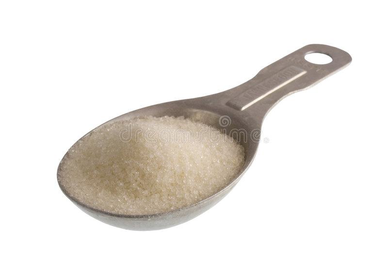 Tablespoon of white sugar. Measuring tablespoon of white sugar isolated on white, clipping path included royalty free stock photo
