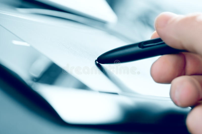 Tablet. Blurred blue toned close up view of man working with tablet stock photos