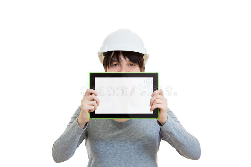 Tablet blank screen presentation. Young man engineer wearing protective helmet new project presentation cover half face using a tablet computer gadget isolated royalty free stock images