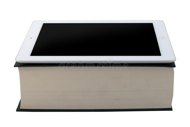 Tablet and book stock image