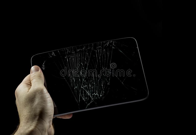 Tablet with a broken screen on a white background. stock photography