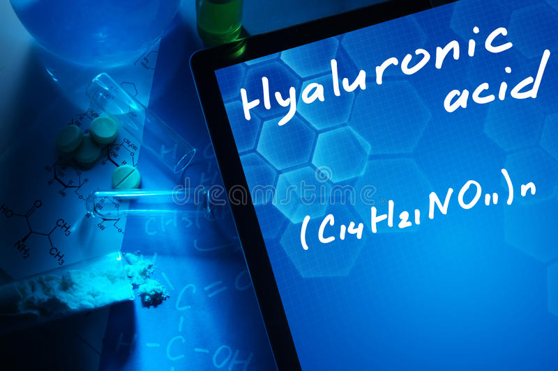 Tablet with the chemical formula of hyaluronic acid. stock image