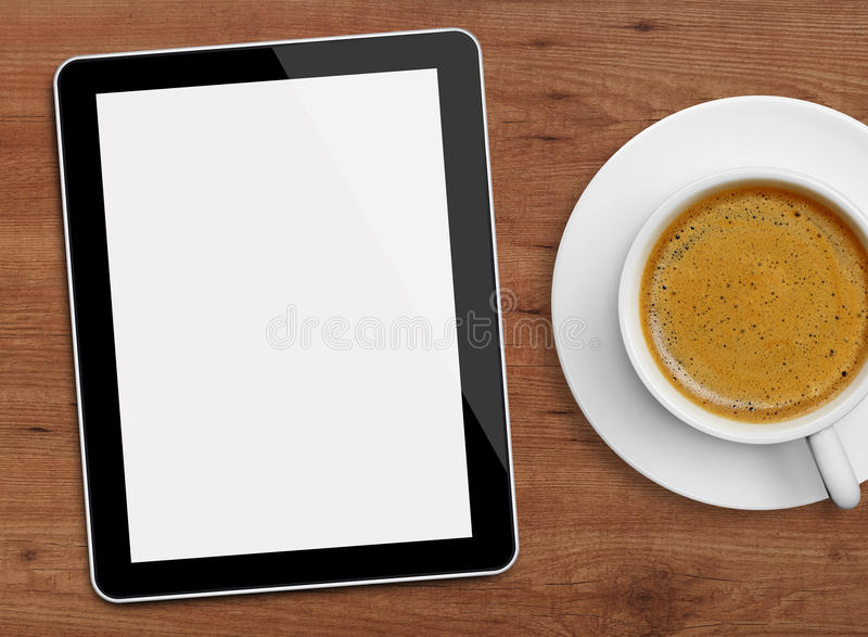 Tablet and coffee cup royalty free stock photos