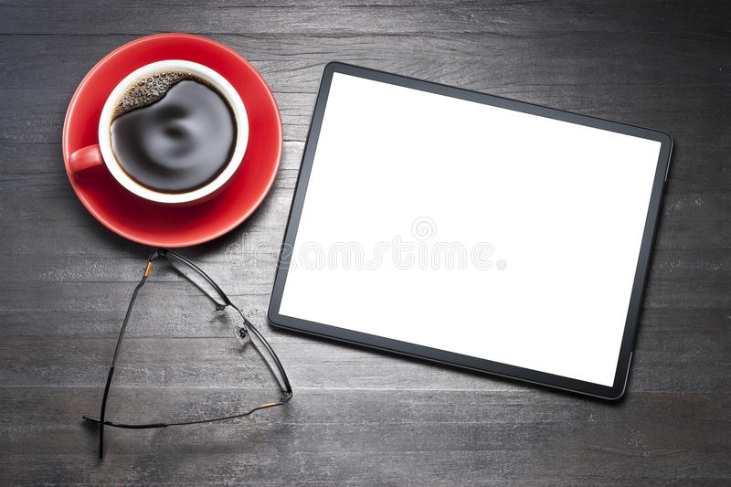 Tablet Computer Business Desk. A tablet computer still-life with coffee cup and reading glasses stock images