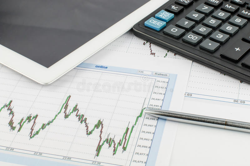 Tablet computer, calculator, pen and business graph on white background. stock image