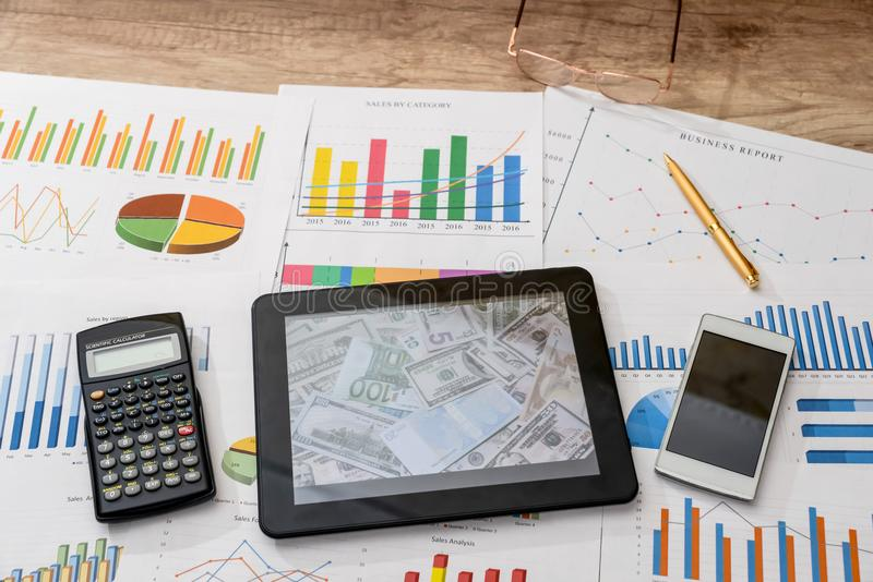 Tablet computer and financial charts, calculator. Tablet computer and financial charts calculator, pen royalty free stock image