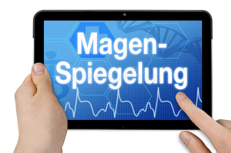 Tablet computer with the german word for gastroscopy - Magenspiegelung stock images