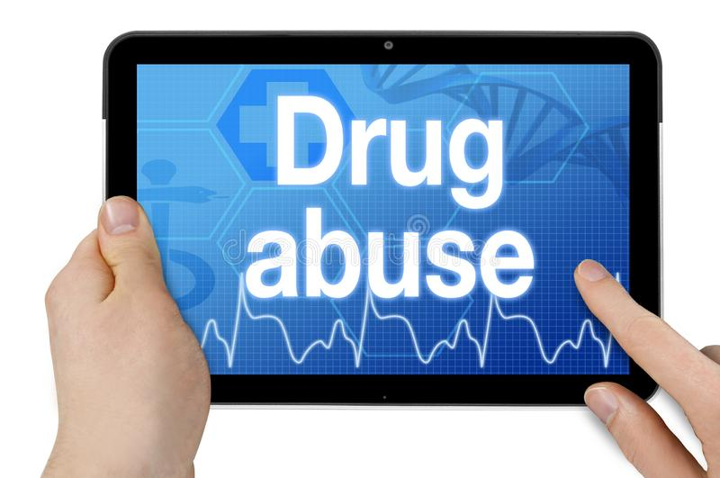 Tablet computer with drug abuse royalty free stock image
