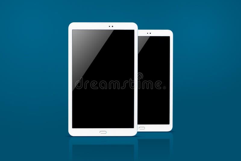 Tablet-Computer lokalisiert auf blauem Hintergrund stockbild