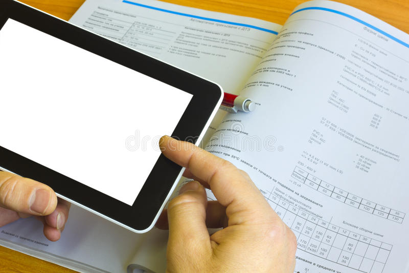 Tablet computer over engineering journal stock images