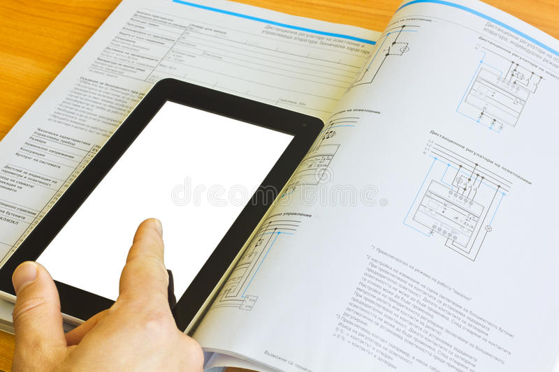 Tablet computer over engineering journal royalty free stock photos