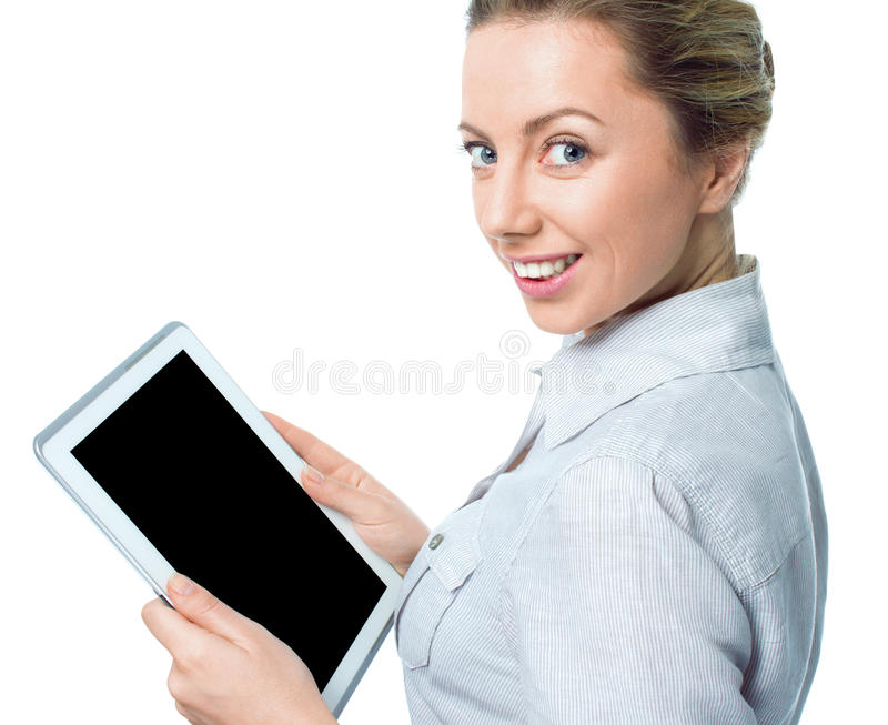Tablet computer. Woman using digital tablet computer PC happy isolated on white background. Focus on both tablet and face. Beautiful woman in business shirt royalty free stock photography