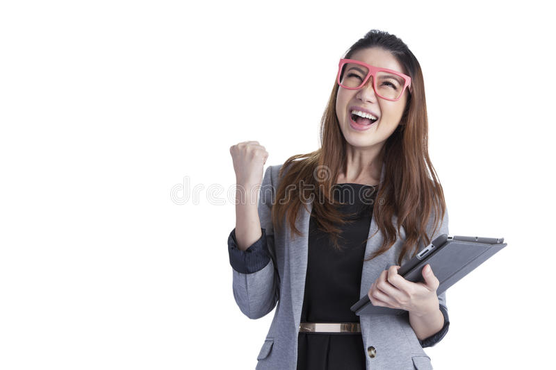 Tablet computer woman winning happy excited. Looking at screen isolated on white background. Joyful fresh and energetic multiracial young woman.Note to editor stock images