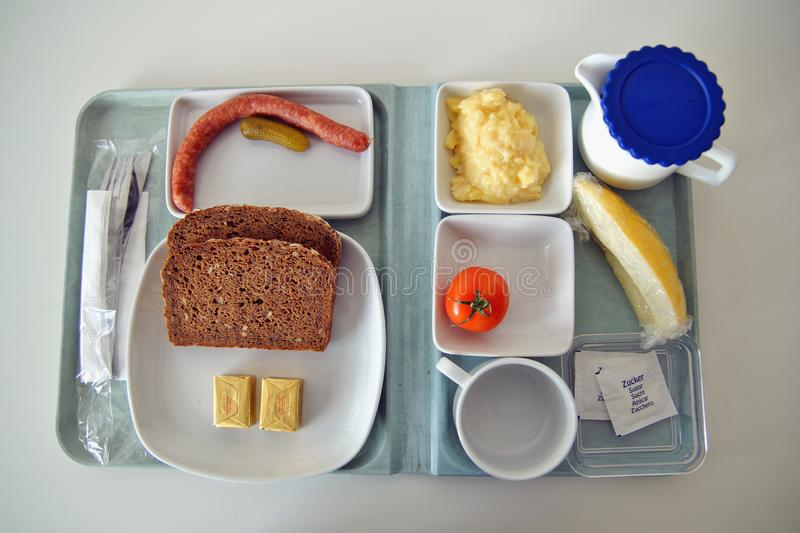 Scanty Food on a tablet like you can find in a canteen of hospital, university and similar places. Tablet with dinner plate Food in hospital stock image