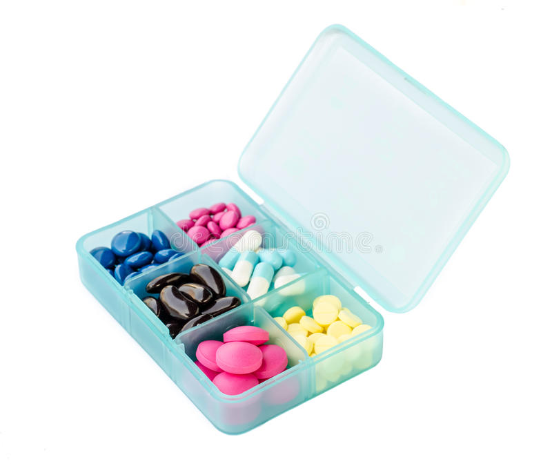 Tablet dispenser with pills. Tablet dispenser with many medicine pills isolated on white back stock photos