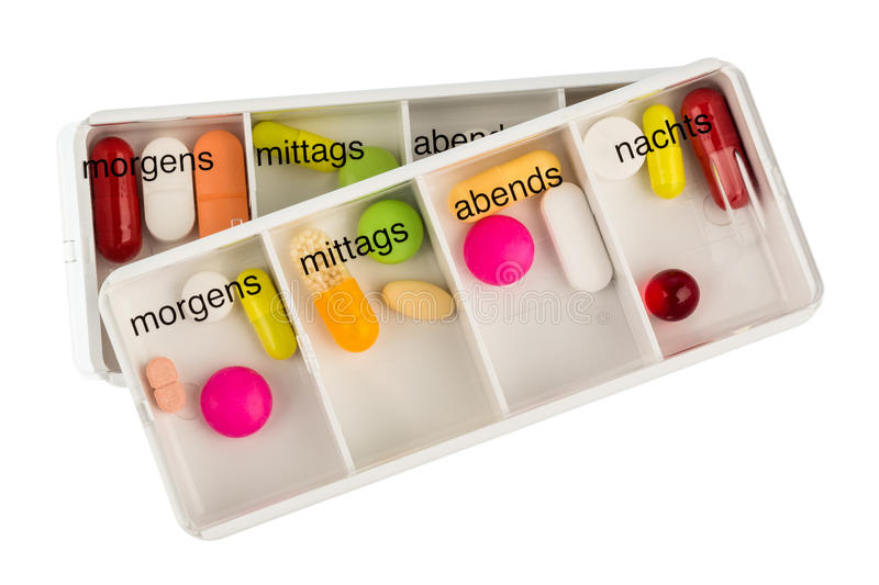 Tablet dispenser and tablets. Tablet dispenser, symbolfoto for therapy, regulation and dosage royalty free stock image