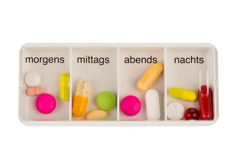 Tablet dispenser and tablets. Tablet dispenser, symbolfoto for therapy, regulation and dosage stock photo