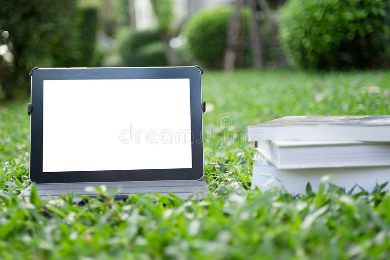 Tablet on grass stock photography
