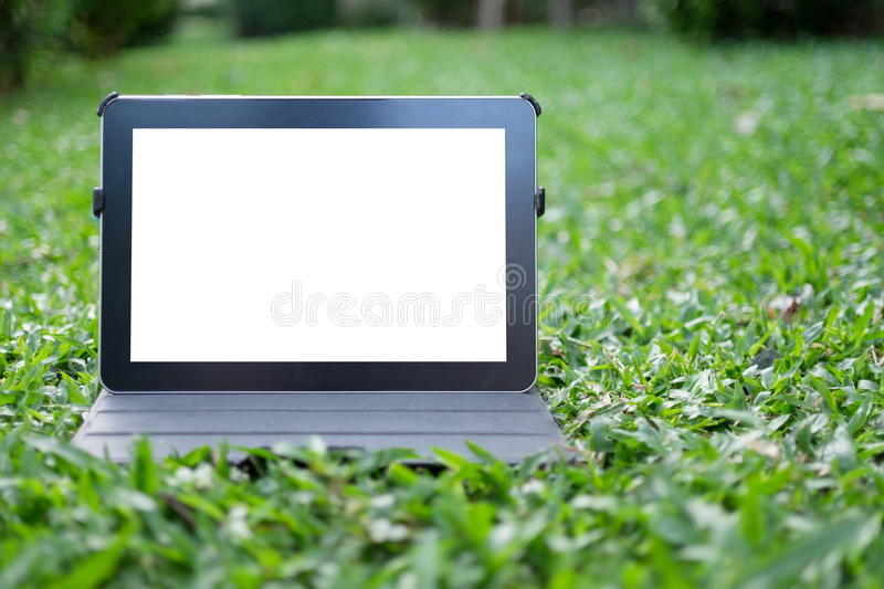 Tablet on grass royalty free stock image