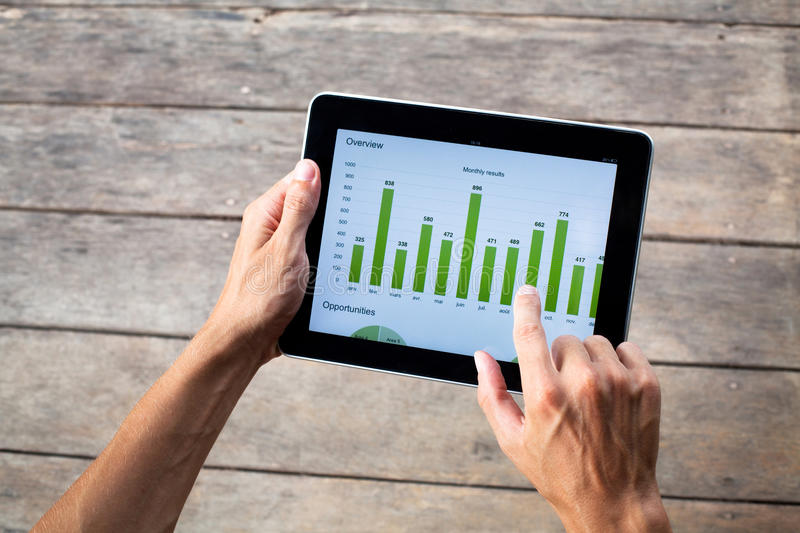 Tablet with green chart. In hands of business man stock images