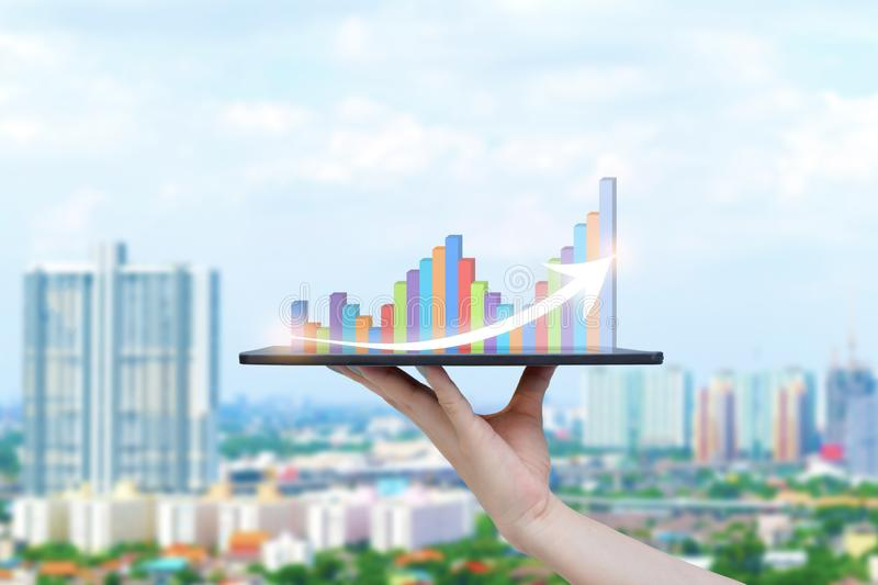 Tablet on hand growth progress graph analysis or success business stock photos
