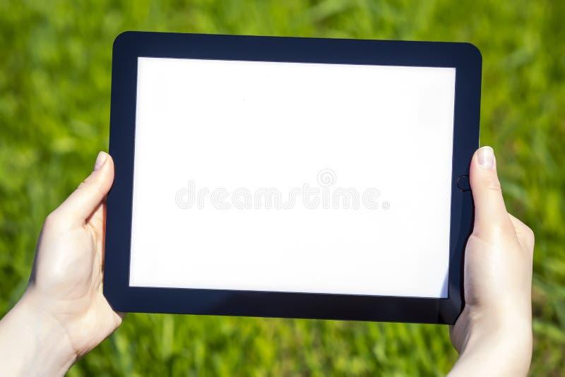 Tablet i hand arkivbilder