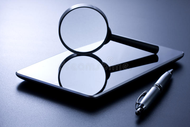 Tablet Magnifying Glass and Pen royalty free stock image