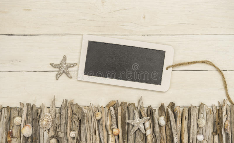 Tablet with maritime decorated white wood background royalty free stock photos