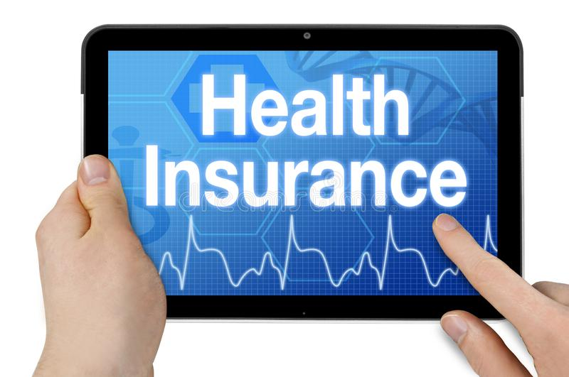 Tablet with medical device and health insurance. Isolated stock photos