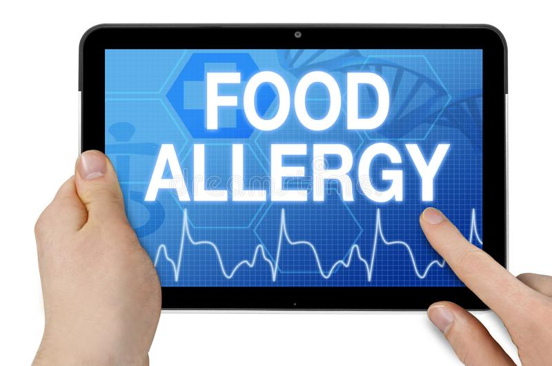 Tablet with medical device touchscreen and food allergy. Isolated stock photos
