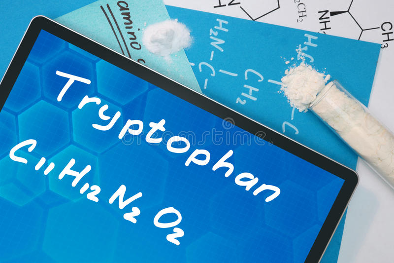 Tablet met de chemische formule van Tryptofaan stock foto